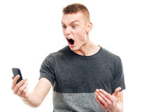 Angry man screaming on the phone Royalty Free Stock Images