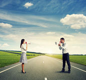 Angry man and screaming woman on the road Royalty Free Stock Image