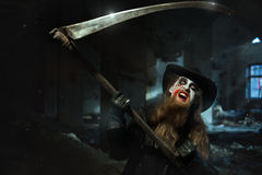 Angry man with the scythe. Angry man swung his scythe and wants to kill Royalty Free Stock Photo