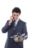 Angry man seeking lunch on mobile phone. Angry man in suit seeking lunch on mobile phone with expression Royalty Free Stock Images