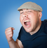 Angry man shakes a fist Royalty Free Stock Images
