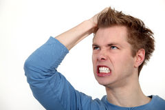 Angry man shouting. And holding his head Royalty Free Stock Photography