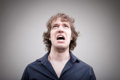 Angry man shouting and cursing Royalty Free Stock Images