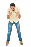 Angry man shouting at the floor Stock Image