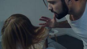 Angry man shouting at his girlfriend. Negativity. Young bearded man shouting at his girlfriend and pointing at her while expressing anger and dissatisfaction stock video footage