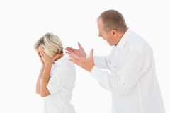 Angry man shouting at his partner Stock Photos