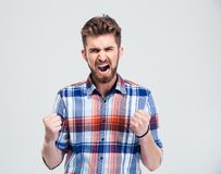 Angry man shouting. Isolated on a white background. Looking at camera Stock Photography