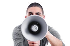 Angry man shouting on a megaphone Royalty Free Stock Image