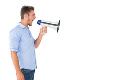 Angry man shouting through megaphone Stock Photography