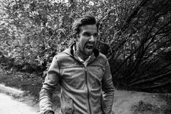 Angry man shouting outdoors