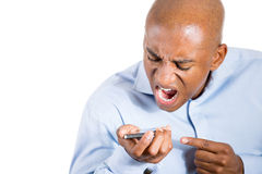 Angry man shouting while on phone Stock Photography