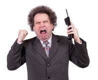 Angry man shouting into a phone Royalty Free Stock Image