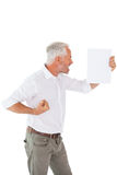 Angry man shouting at piece of paper Stock Photos