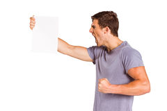 Angry man shouting at piece of paper Royalty Free Stock Photos