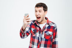 Angry man shouting on smartphone. Isolated on a white background Stock Photography