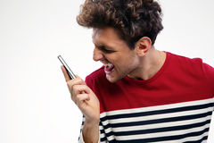 Angry man shouting at smartphone Royalty Free Stock Photo