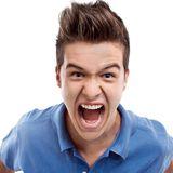 Angry man shouting. Angry young man looking straight forward and shouting Royalty Free Stock Photos