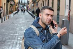 Angry man showing extreme dependency with his smartphone.  royalty free stock image