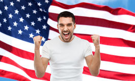 Angry man showing fists over american flag Royalty Free Stock Photos
