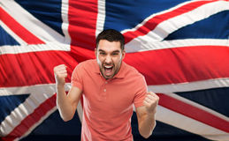 Angry man showing fists over brittish flag royalty free stock image