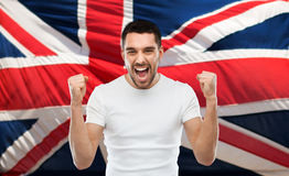 Angry man showing fists over brittish flag Stock Images