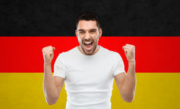 Angry man showing fists over german flag Royalty Free Stock Photography