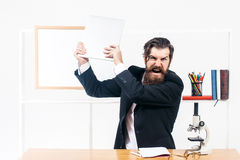 Angry man smashes laptop Stock Photos