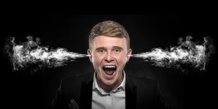 Angry man with smoke coming out from his ears. Stock Photography