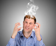 Angry  man  smoke from the head Royalty Free Stock Photography