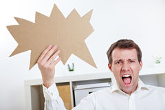 Angry man with speech balloon Stock Photography