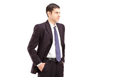 Angry man in suit with hands in pockets shot during an argue Royalty Free Stock Photo