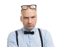 Angry man with suspenders and bow-tie Stock Image