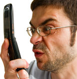 Angry Man Talking By Phone Stock Photo