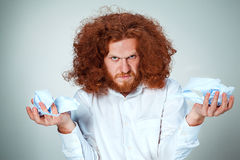 Angry man tear out paper Royalty Free Stock Images