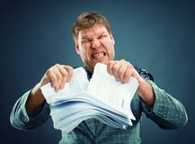 Angry man tear out paper Stock Photos
