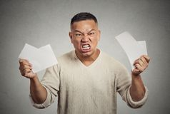 Angry man tearing business documents to pieces Stock Image