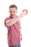 Angry man throwing a flower Stock Images