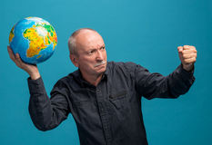 Angry man throwing globe Stock Images