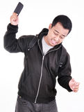 Angry man throwing his mobile phone. Isolated on white background Royalty Free Stock Photo