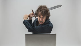 Angry man about to destroy his laptop Royalty Free Stock Images