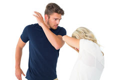Angry man about to hit his girlfriend Stock Photos