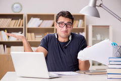 The angry man with too much paperwork to do Royalty Free Stock Photography