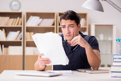 The angry man with too much paperwork to do Stock Photos