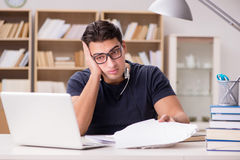 The angry man with too much paperwork to do Royalty Free Stock Photos