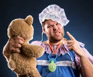 Angry man with toy bear Stock Photos