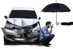 Angry man with umbrella and broken car Royalty Free Stock Image