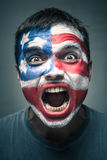 Angry man with USA flag painted on face Royalty Free Stock Photography