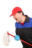 Angry Man in workwear with mop Stock Photo