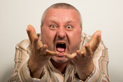 Angry man yelling at camera pointing with hands Royalty Free Stock Image