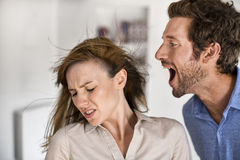 Angry man yelling at his wife Royalty Free Stock Image